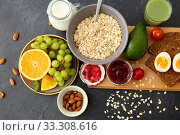 oatmeal, fruits, toast bread, egg, jam and milk. Стоковое фото, фотограф Syda Productions / Фотобанк Лори