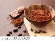 Купить «chocolate with hazelnuts, cocoa beans and powder», фото № 33308620, снято 1 февраля 2019 г. (c) Syda Productions / Фотобанк Лори