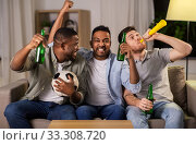 Купить «friends or soccer fans with ball and beer at home», фото № 33308720, снято 28 декабря 2019 г. (c) Syda Productions / Фотобанк Лори