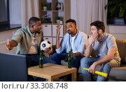 Купить «friends with ball and vuvuzela watching soccer», фото № 33308748, снято 28 декабря 2019 г. (c) Syda Productions / Фотобанк Лори