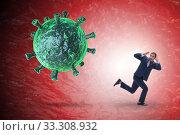 Купить «Businessman in fear of recession due to coronavirus», фото № 33308932, снято 1 апреля 2020 г. (c) Elnur / Фотобанк Лори