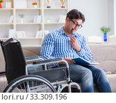 Купить «Young student on wheelchair in disability concept», фото № 33309196, снято 6 апреля 2017 г. (c) Elnur / Фотобанк Лори