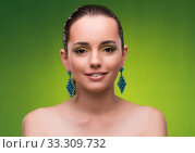 Young woman in beauty concept on green background. Стоковое фото, фотограф Elnur / Фотобанк Лори