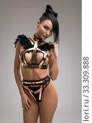 Купить «Slim girl in bdsm style gold lingerie view», фото № 33309888, снято 5 февраля 2020 г. (c) Гурьянов Андрей / Фотобанк Лори