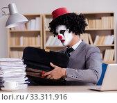 Купить «Clown businessman working in the office», фото № 33311916, снято 3 ноября 2016 г. (c) Elnur / Фотобанк Лори