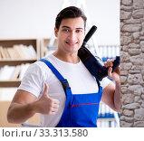 Купить «Repairman working with drilling drill perforator», фото № 33313580, снято 9 декабря 2016 г. (c) Elnur / Фотобанк Лори