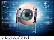 Купить «Doctor examining giant eye in medical concept», фото № 33313964, снято 9 апреля 2020 г. (c) Elnur / Фотобанк Лори