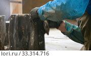Купить «Concrete industry - worker wiping out the black detail after putting it out from the form», видеоролик № 33314716, снято 5 июня 2020 г. (c) Константин Шишкин / Фотобанк Лори