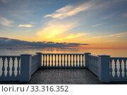 Купить «Beautiful building with columns on a landscaped promenade at sunset», фото № 33316352, снято 17 февраля 2020 г. (c) Иванов Алексей / Фотобанк Лори