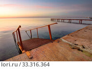 Seascape, staircase descends into the sea, on the far side of the pier. Стоковое фото, фотограф Иванов Алексей / Фотобанк Лори