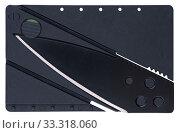 Миниатюрный складной нож размером с банковскую карточку, изолировано на белом фоне. Стоковое фото, фотограф Игорь Долгов / Фотобанк Лори