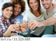 Купить «Closeup of friends cheering with glass of wine», фото № 33329688, снято 12 июля 2020 г. (c) PantherMedia / Фотобанк Лори