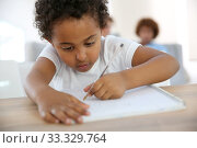 Купить «Portrait of little boy drawing with pen», фото № 33329764, снято 9 апреля 2020 г. (c) PantherMedia / Фотобанк Лори