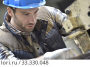 Купить «Industrial worker working on machine in factory», фото № 33330048, снято 5 июля 2020 г. (c) PantherMedia / Фотобанк Лори