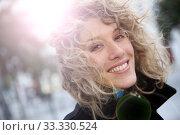 Купить «Smiling attractive woman in town in winter time», фото № 33330524, снято 25 мая 2020 г. (c) PantherMedia / Фотобанк Лори