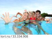 Купить «Happy family enjoying bath time in infinity pool», фото № 33334908, снято 8 апреля 2020 г. (c) PantherMedia / Фотобанк Лори