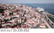 Купить «Picturesque aerial view of historical areas of Lisbon on bank of Tagus river overlooking medieval Roman Catholic Cathedral, Portugal», видеоролик № 33335652, снято 20 апреля 2019 г. (c) Яков Филимонов / Фотобанк Лори