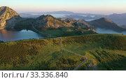 Купить «Picturesque landscape of highland Lakes of Covadonga within Picos de Europa National Park at sunset», видеоролик № 33336840, снято 15 июля 2019 г. (c) Яков Филимонов / Фотобанк Лори