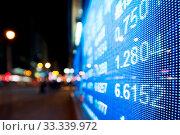 Купить «Display of Stock market quotes beside street», фото № 33339972, снято 16 июля 2020 г. (c) easy Fotostock / Фотобанк Лори