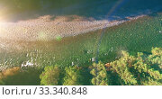Купить «Low altitude flight over fresh fast mountain river with rocks at sunny summer morning.», видеоролик № 33340848, снято 4 апреля 2019 г. (c) Александр Маркин / Фотобанк Лори