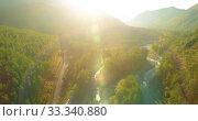 Купить «Low altitude flight over fresh fast mountain river with rocks at sunny summer morning.», видеоролик № 33340880, снято 5 апреля 2019 г. (c) Александр Маркин / Фотобанк Лори