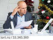 Купить «Busy businessman worrying at the computer», фото № 33343360, снято 10 января 2019 г. (c) Яков Филимонов / Фотобанк Лори