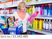 woman choosing household chemical goods. Стоковое фото, фотограф Яков Филимонов / Фотобанк Лори