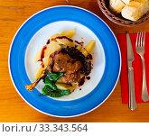 Купить «Duck confit in port with pear chutney», фото № 33343564, снято 29 марта 2020 г. (c) Яков Филимонов / Фотобанк Лори