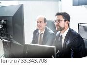 Купить «Business team analyzing data at business meeting in modern corporate office.», фото № 33343708, снято 10 января 2020 г. (c) Matej Kastelic / Фотобанк Лори