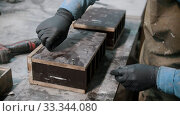 Купить «Concrete industry - man applying screws in the big concrete item», видеоролик № 33344080, снято 5 июня 2020 г. (c) Константин Шишкин / Фотобанк Лори