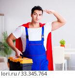 Купить «Superhero repairman with tools in repair concept», фото № 33345764, снято 23 декабря 2016 г. (c) Elnur / Фотобанк Лори