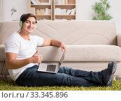 Купить «Freelancer working at home and listening to music», фото № 33345896, снято 25 октября 2016 г. (c) Elnur / Фотобанк Лори