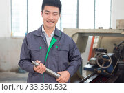 Купить «Young chinese man works in motor manufacturing factory», фото № 33350532, снято 13 июля 2020 г. (c) easy Fotostock / Фотобанк Лори