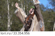 Woman expression dancing in traditional clothing of indigenous people Kamchatka Peninsula. Itelmens national ritual festival thanksgiving nature Alhalalalay (2019 год). Редакционное видео, видеограф А. А. Пирагис / Фотобанк Лори