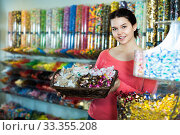 Купить «Photo of girl in the shop with lots of sweets», фото № 33355208, снято 22 марта 2017 г. (c) Яков Филимонов / Фотобанк Лори
