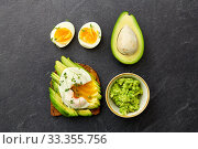 Купить «toast bread with avocado, pouched egg and greens», фото № 33355756, снято 1 ноября 2018 г. (c) Syda Productions / Фотобанк Лори