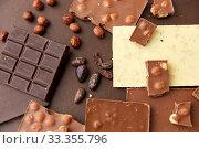 Купить «chocolate bars with hazelnuts and cocoa beans», фото № 33355796, снято 1 февраля 2019 г. (c) Syda Productions / Фотобанк Лори