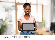 Купить «african american woman with tablet pc at office», фото № 33355980, снято 26 января 2020 г. (c) Syda Productions / Фотобанк Лори