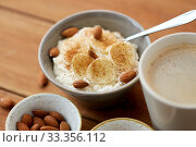 oatmeal with banana and almond on wooden table. Стоковое фото, фотограф Syda Productions / Фотобанк Лори