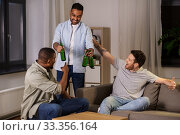 Купить «happy male friends drinking beer at home at night», фото № 33356164, снято 28 декабря 2019 г. (c) Syda Productions / Фотобанк Лори
