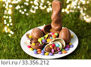 chocolate bunny, eggs and candy drops on plate. Стоковое фото, фотограф Syda Productions / Фотобанк Лори