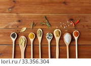Купить «spoons with spices and salt on wooden table», фото № 33356304, снято 6 сентября 2018 г. (c) Syda Productions / Фотобанк Лори