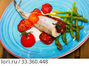 Blue whiting fish baked with dried tomatoes. Стоковое фото, фотограф Яков Филимонов / Фотобанк Лори