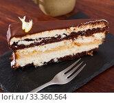 Купить «Piece of chocolate lemon cake on black board», фото № 33360564, снято 15 июля 2020 г. (c) Яков Филимонов / Фотобанк Лори