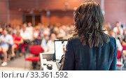 Купить «Female public speaker giving talk at Business Event.», фото № 33361592, снято 3 июля 2014 г. (c) Matej Kastelic / Фотобанк Лори