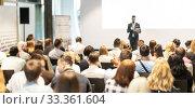 Купить «Male business speaker giving a talk at business conference event.», фото № 33361604, снято 15 июня 2018 г. (c) Matej Kastelic / Фотобанк Лори