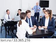 Купить «Employee in charge presenting report», фото № 33365216, снято 28 октября 2016 г. (c) Яков Филимонов / Фотобанк Лори