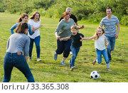 people of different ages playing football. Стоковое фото, фотограф Яков Филимонов / Фотобанк Лори
