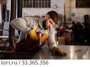 Factory worker with screwdriver. Стоковое фото, фотограф Яков Филимонов / Фотобанк Лори