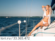 Купить «beautiful woman with a slim figure wearing white bikini swimsuit and lace pareo», фото № 33365472, снято 11 июля 2017 г. (c) katalinks / Фотобанк Лори